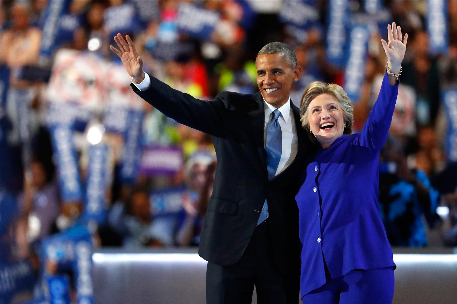 President Barack Obama and Democratic presidential candidate Hillary Clinton wave to the crowd.