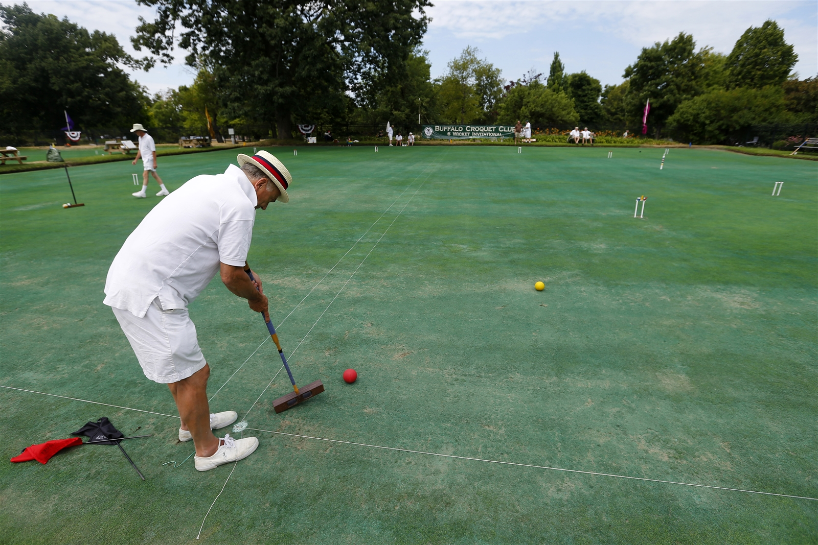 Jim Irwin of Geneseo strikes the ball during the Buffalo Croquet Club Inaugural 6-Wicket Invitational at Delaware Park Saturday.