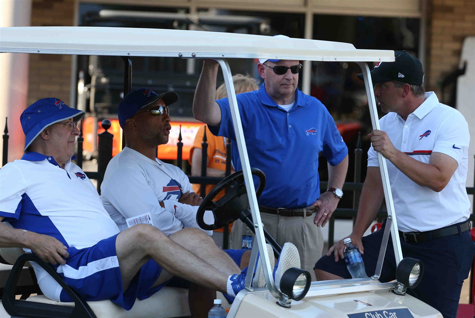 Terry Pegula watches the practice from his golf cart.