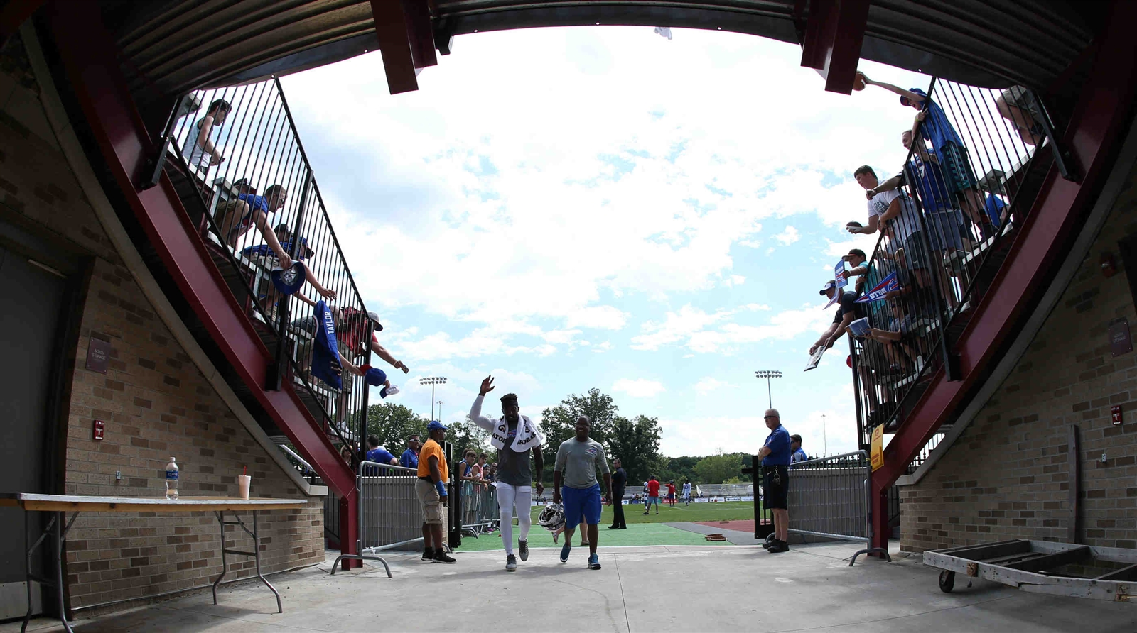 Buffalo Bills quarterback Tyrod Taylor (5) waves to the fans as he leaves practice.