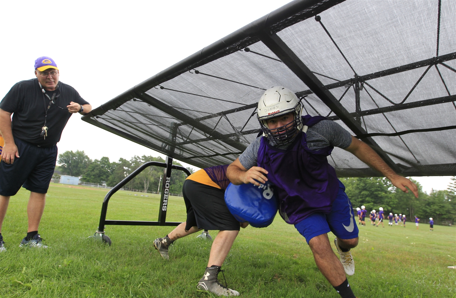 Springville coach Eric Jantzi watches John Domes during practice.