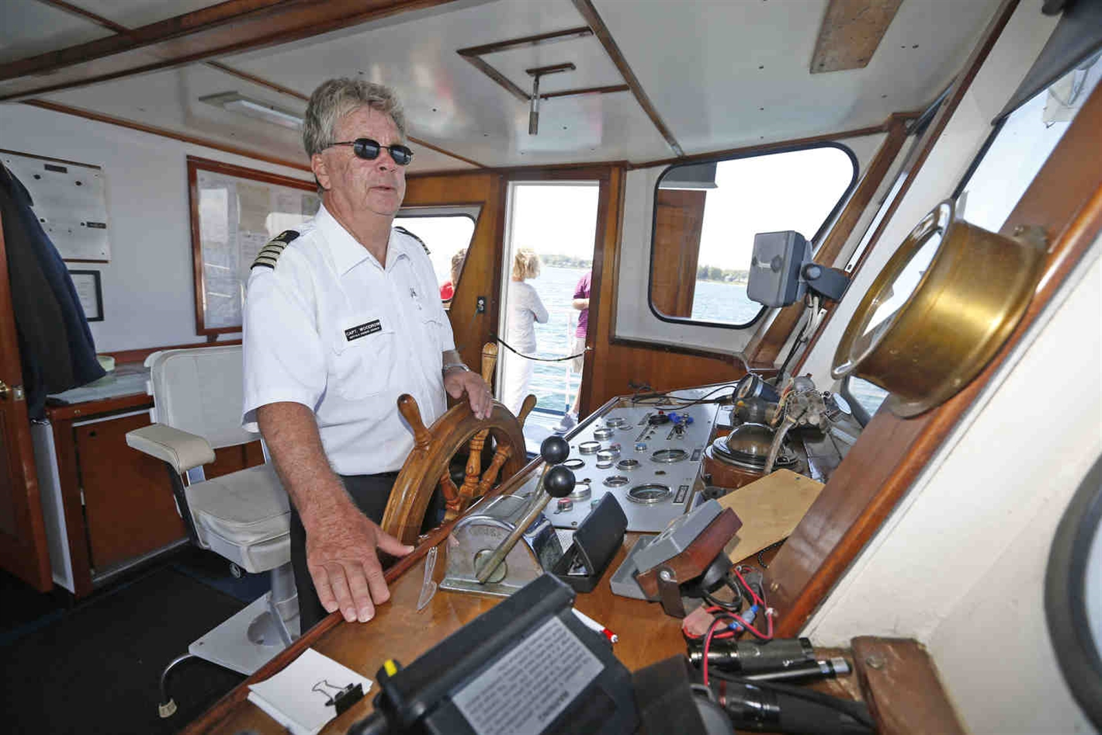 Capt. Tom Woodrow at the helm.