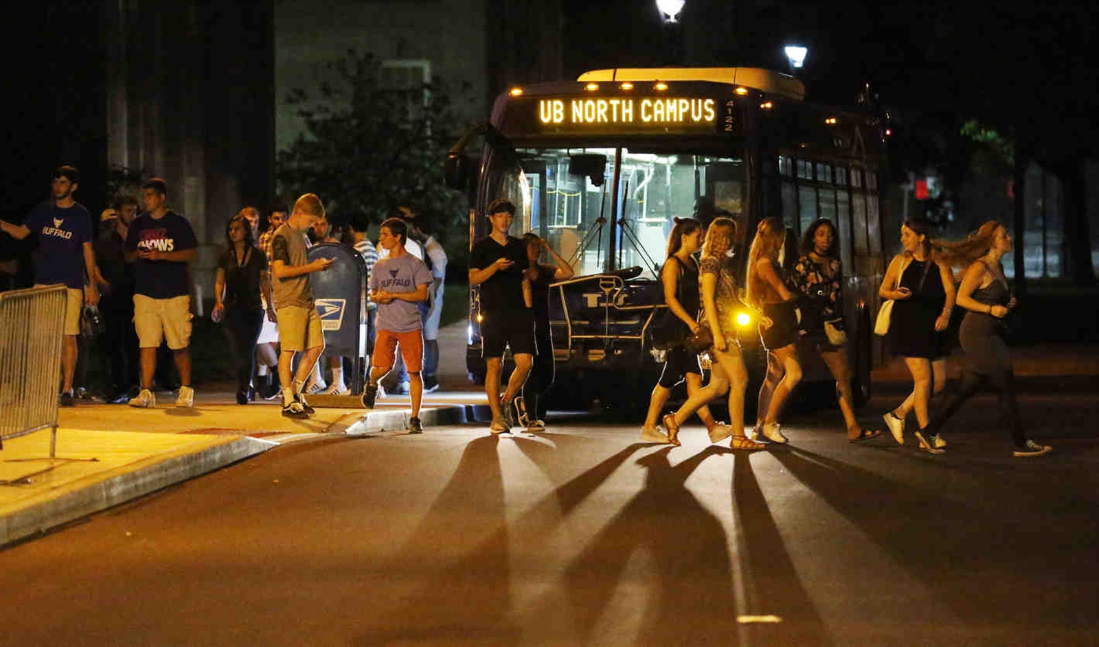 Busloads of students arrive at UB South Campus from the North Campus. Between 11 p.m. and midnight, buses were arriving about every three to five minutes.
