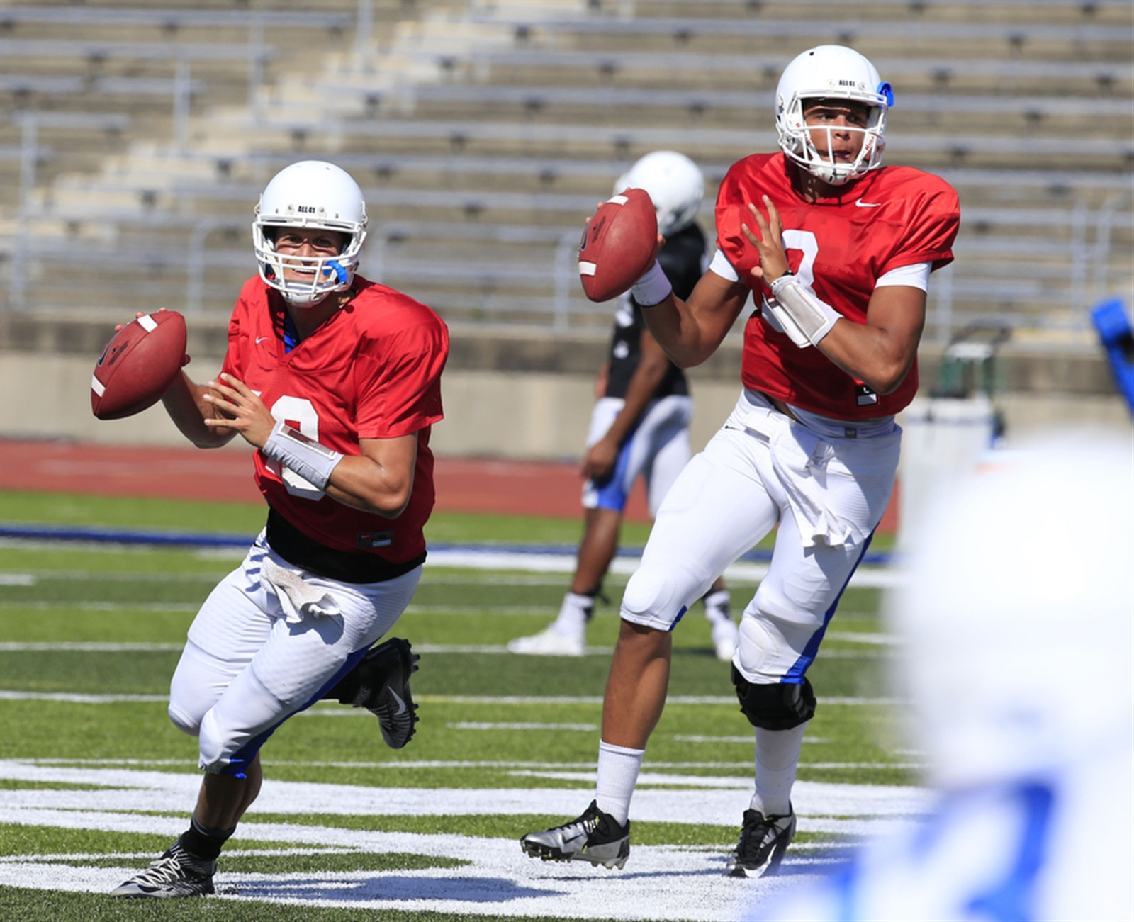 University at Buffalo quarterbacks Grant Rohach (19) and Tyree Jackson (3) take part in drills during practice.
