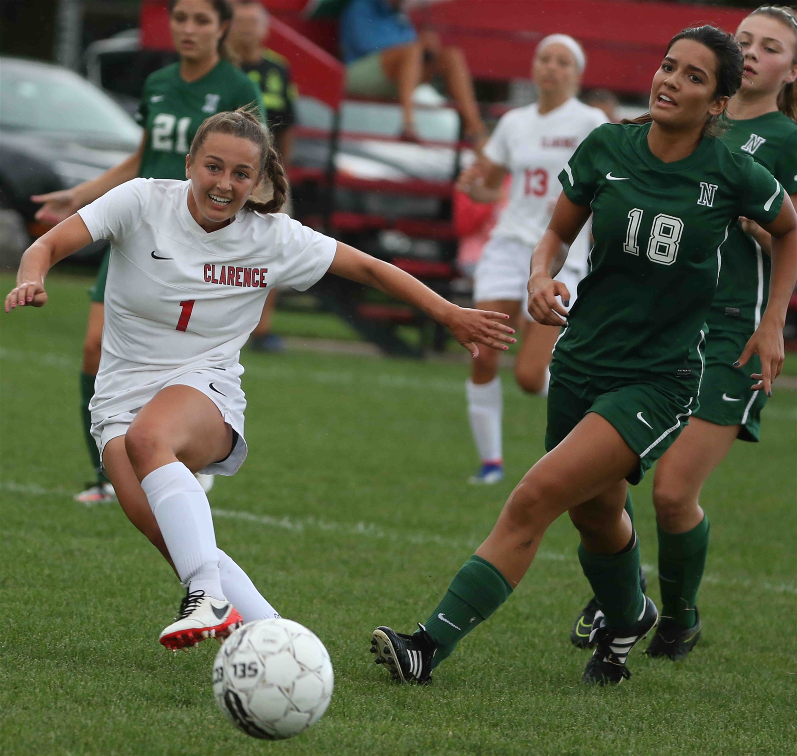 Clarence's Riley Bowers battles Emma Biachi for the ball.