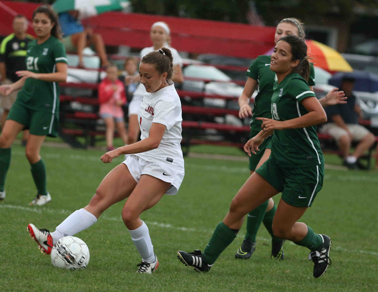 Clarence's Riley Bowers battles Emma Biachi for the ball