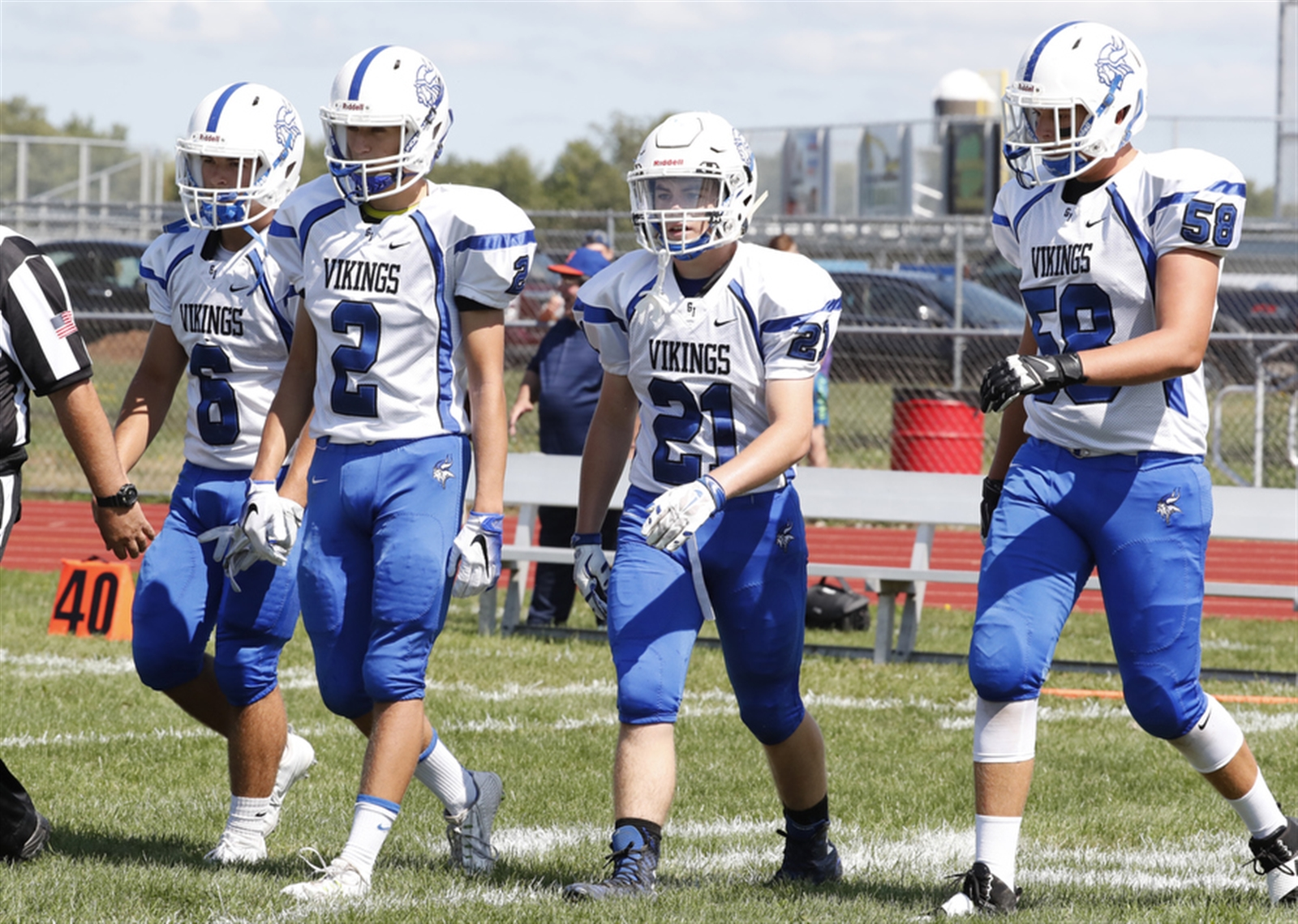 Grand Island captains make their way to the coin toss prior to playing Niagara Wheatfield.