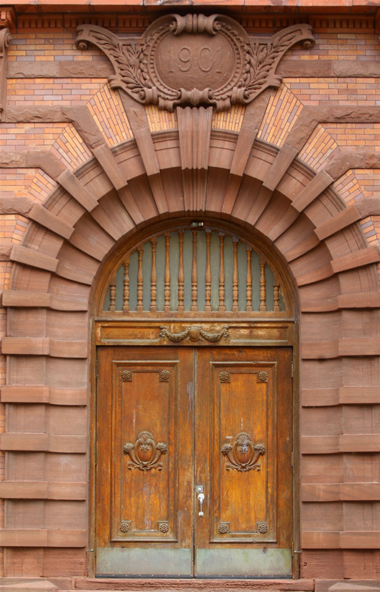 The large oak front doors of Lafayette High School, officially opened on Sept. 10, 1903. Over 1,000 students attended class on the first day of school. The first principal was Arthur Detmers.
