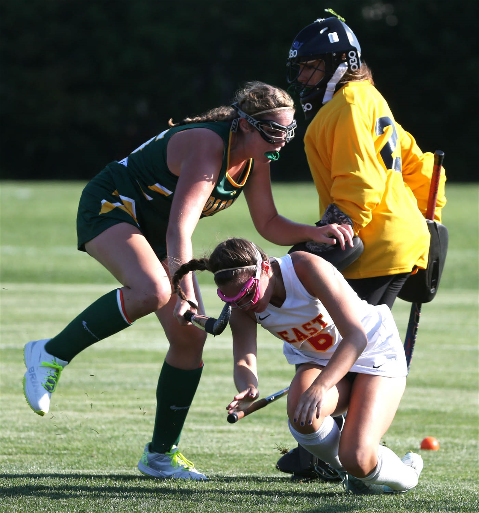 Williamsville East's Hayley Skidmore battles Williamsville North's goalie Samantha Mallare.