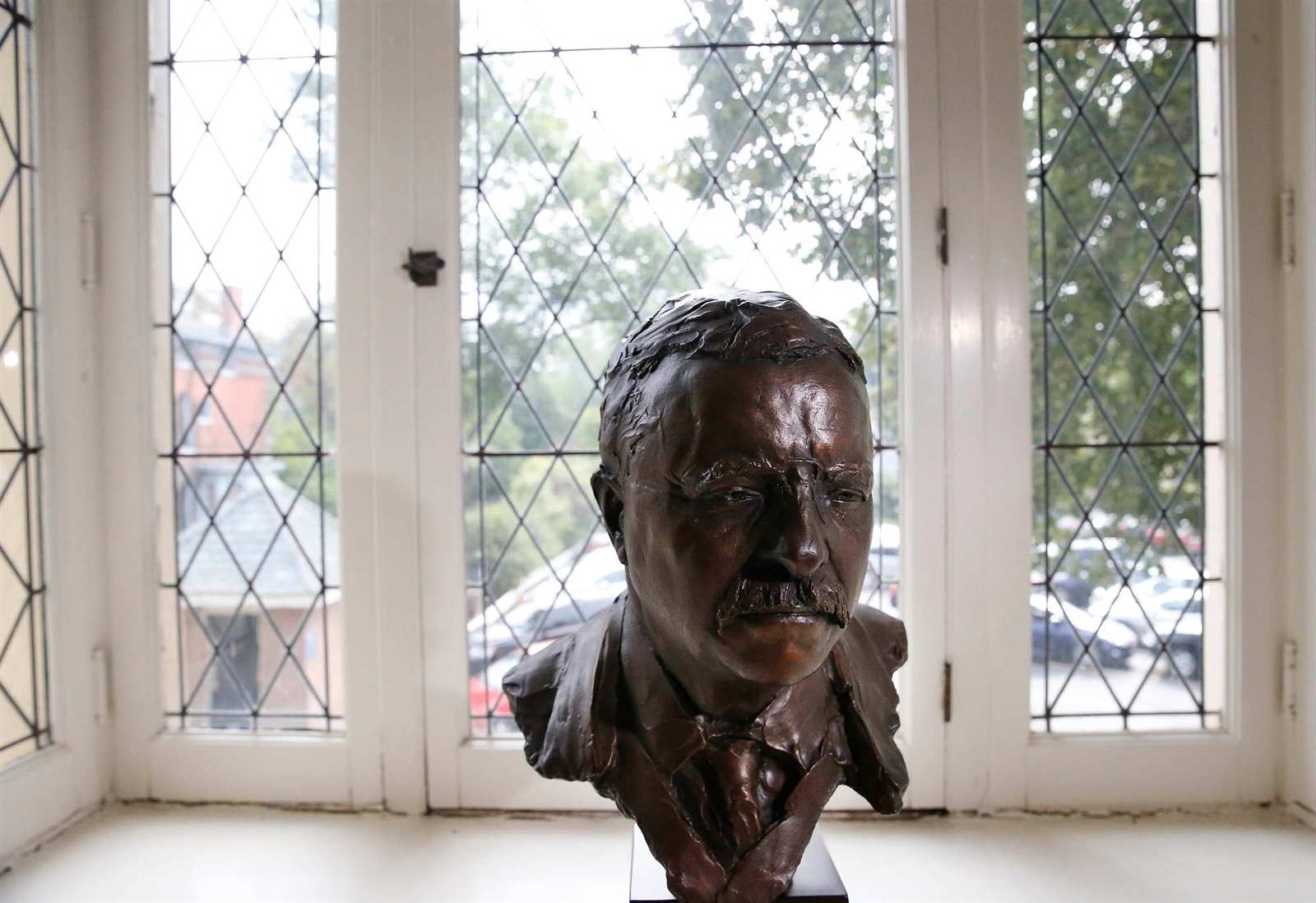 A bust of Theodore Roosevelt sits in a leaded glass window that is original to the 1896 addition to the Wilcox Mansion. Roosevelt was just 42 when he took the oath of office in the suit and long coat he would later wear in President William McKinleyu2019s funeral procession.