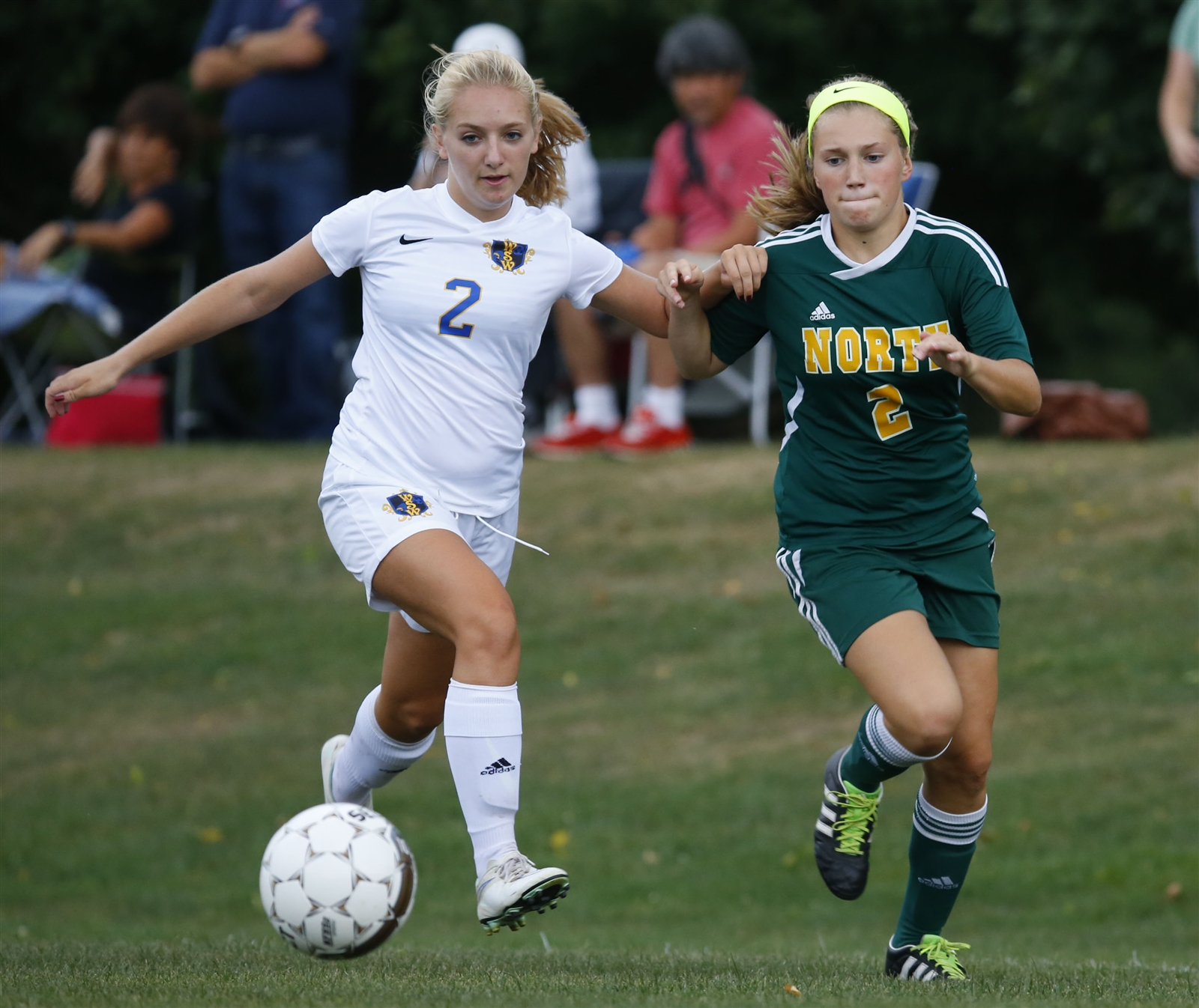 West Seneca West's Cassie Siwy and Williamsville North's Lianna Van Sice battle for a loose ball during first half action at the West Seneca Soccer complex on Thursday, Sept. 8, 2016.