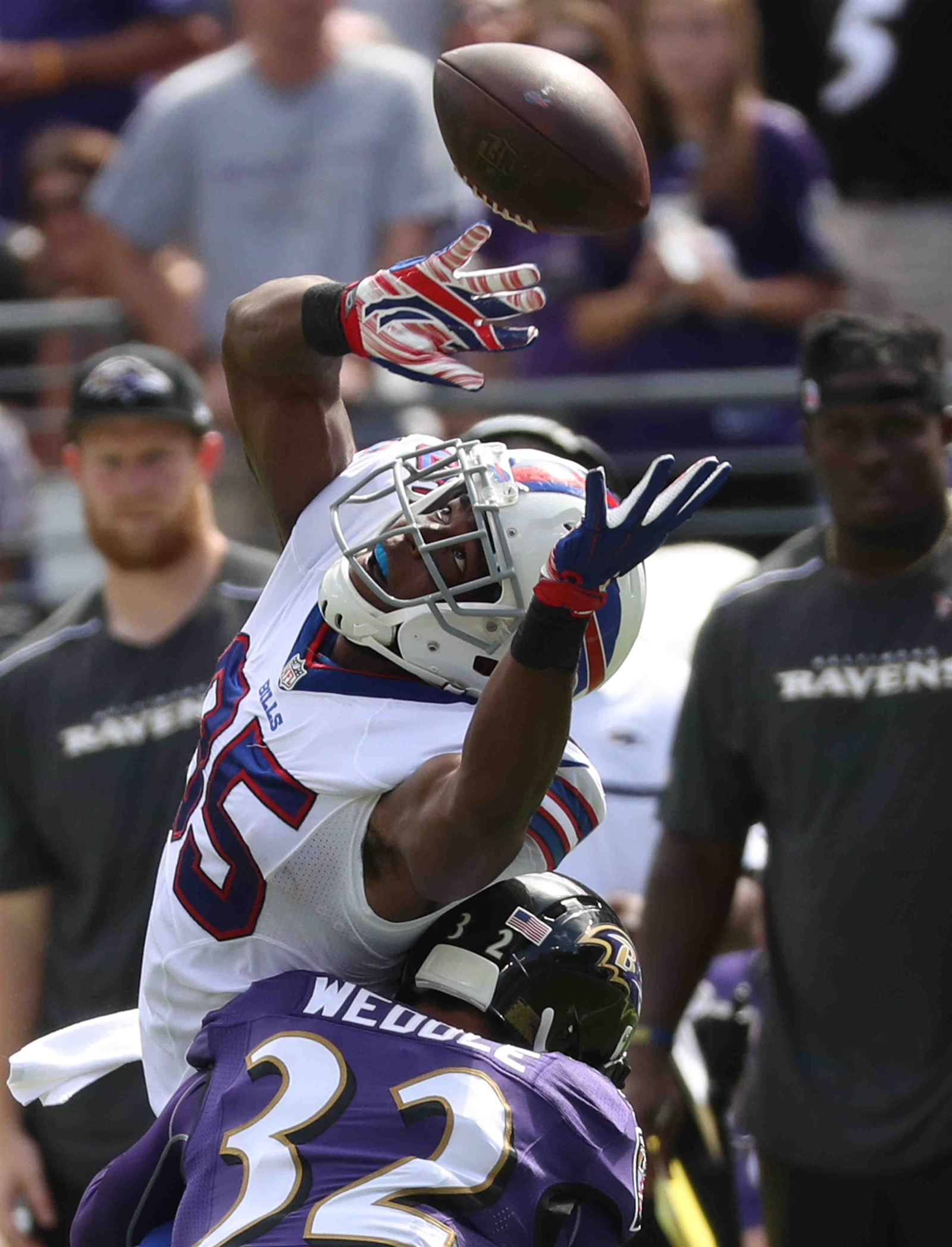 Buffalo Bills tight end Charles Clay drops a apes while covered by Baltimore Ravens defensive back Eric Weddle (32) in the first quarter.