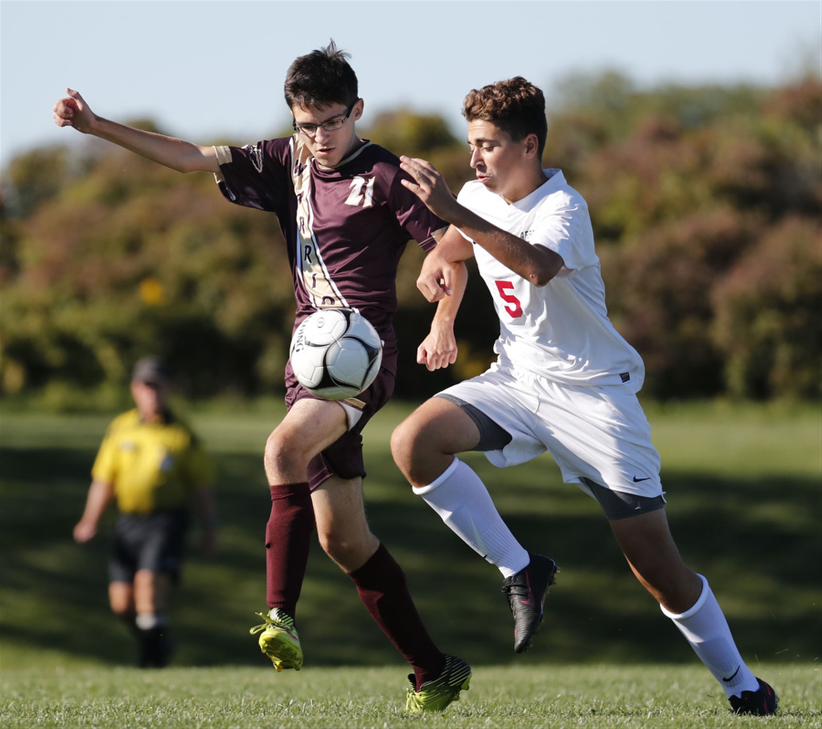 Cheektowaga's Jacob Curr and Starpoint's Riley Richards battle for a loose ball during first-half action.