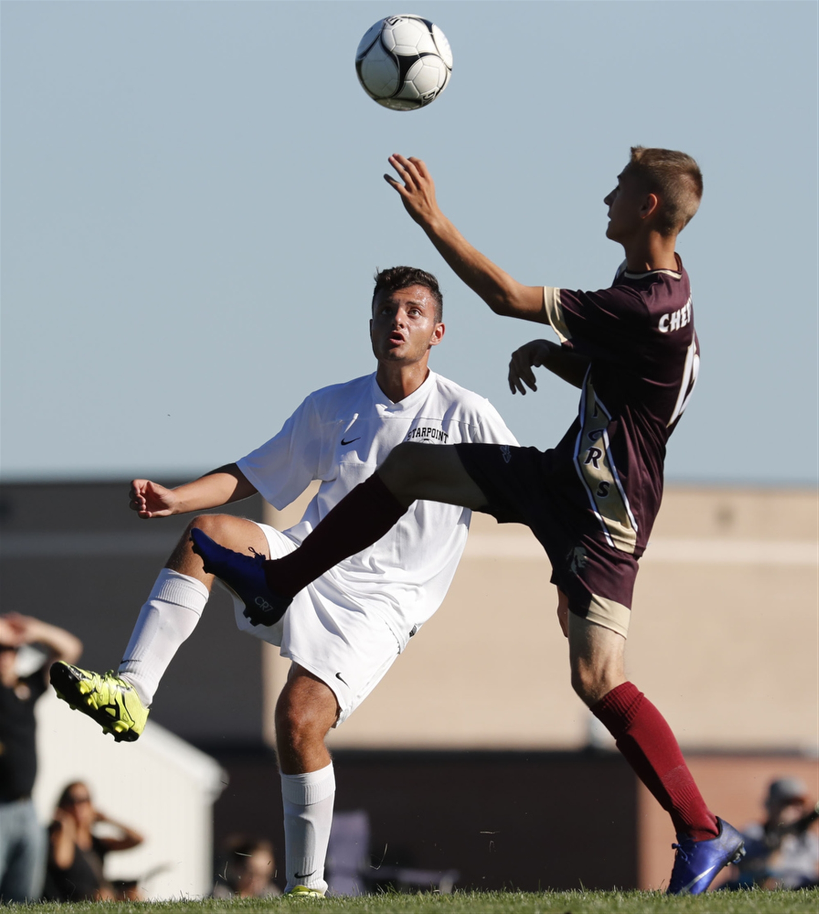 Cheektowaga's Nathan Obstarczyk and Starpoint's Gird Ceno battle for a loose ball during first half action.