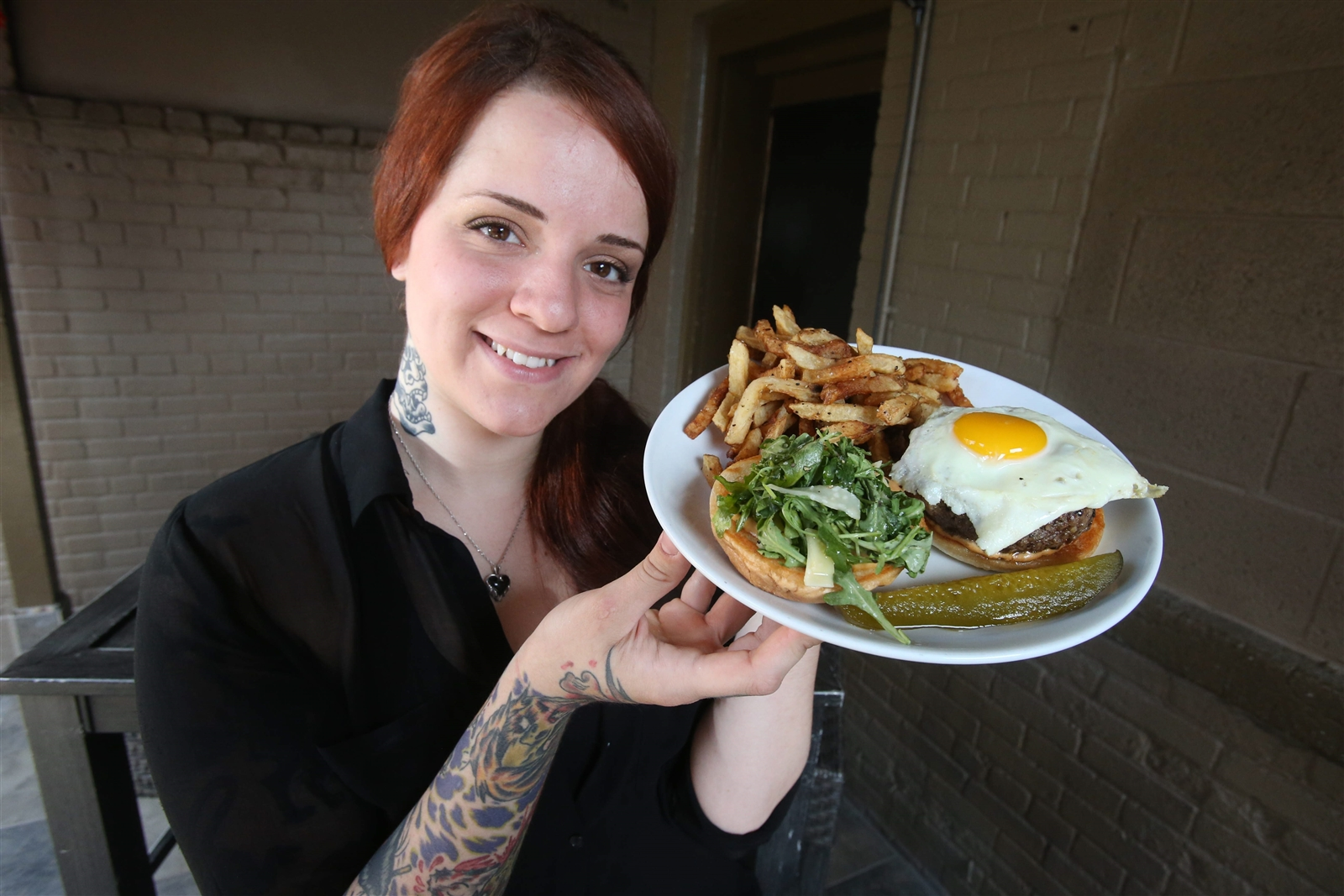 Duke's Bohemian Grove Bar, 253 Allen St., Buffalo (240-9359). This is the Arch Duke of Allentown, a truffled Angus burger with mushrooms, fried egg, and arugula. Do not miss the fries.