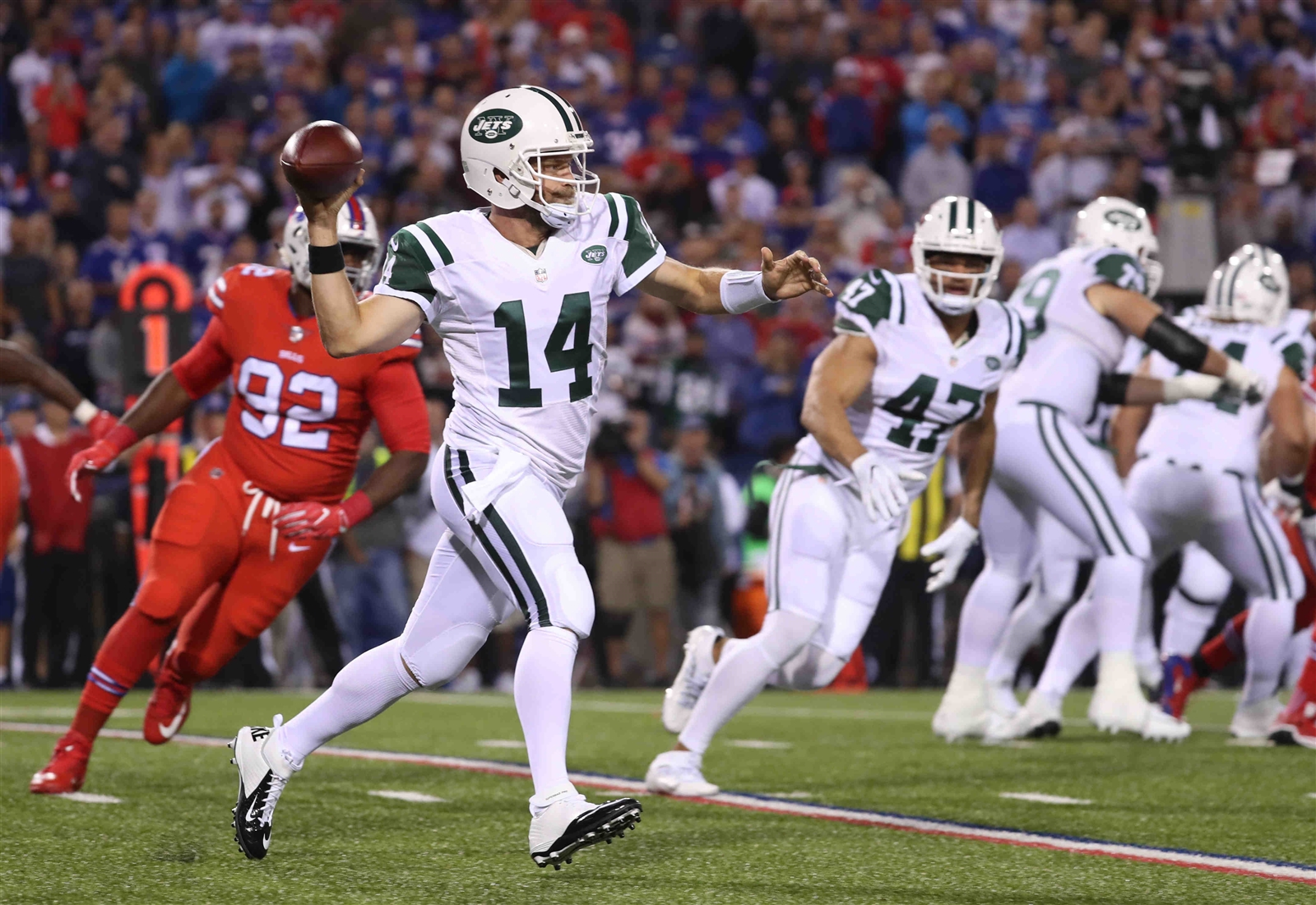 New York Jets quarterback Ryan Fitzpatrick (14) looks to throw during the first quarter.