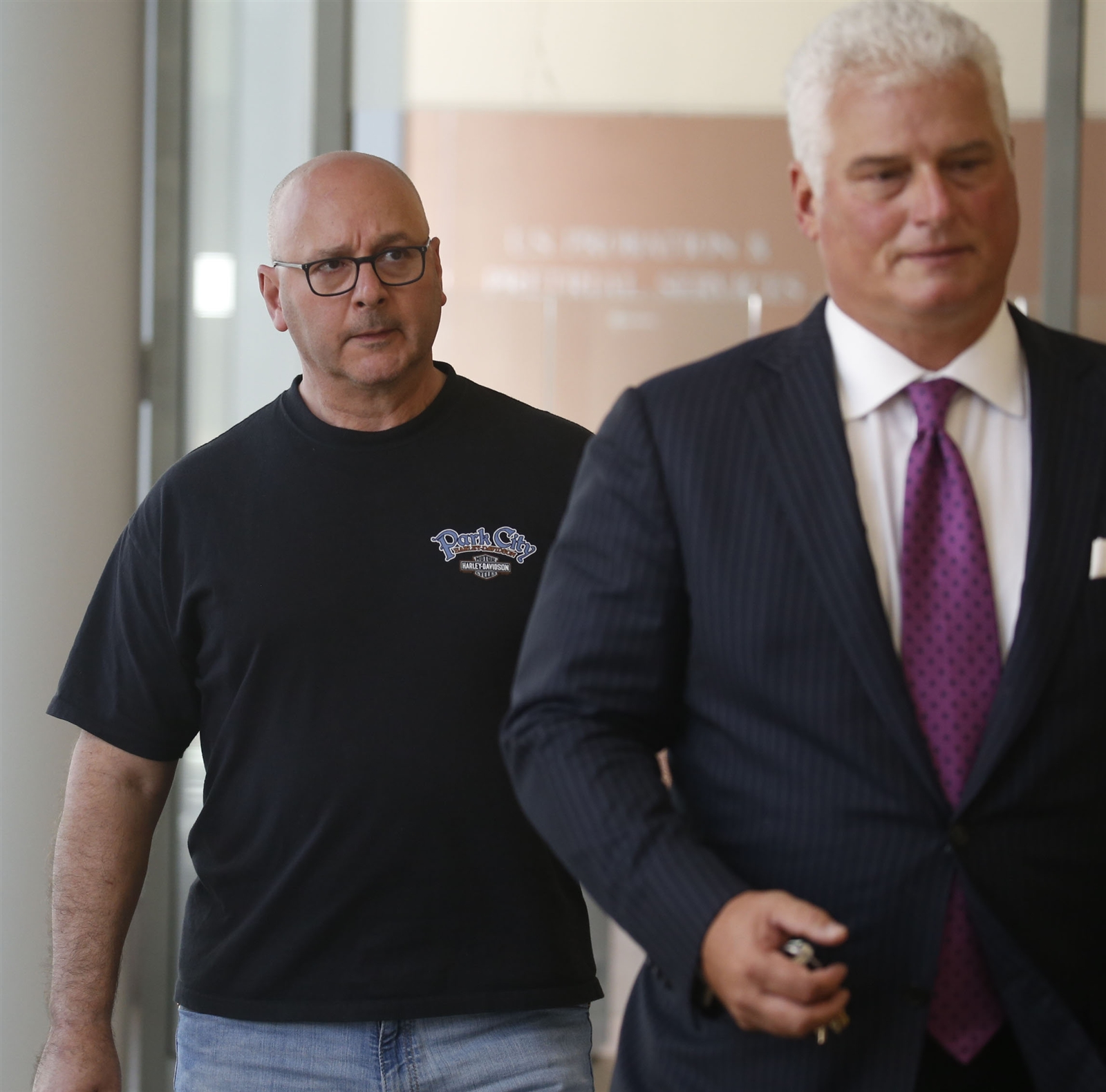 Louis P. Ciminelli, left, gets escorted out of Buffalo Federal court Thursday with his attorney, Daniel C. Oliverio, after facing charges of bid rigging and bribery.