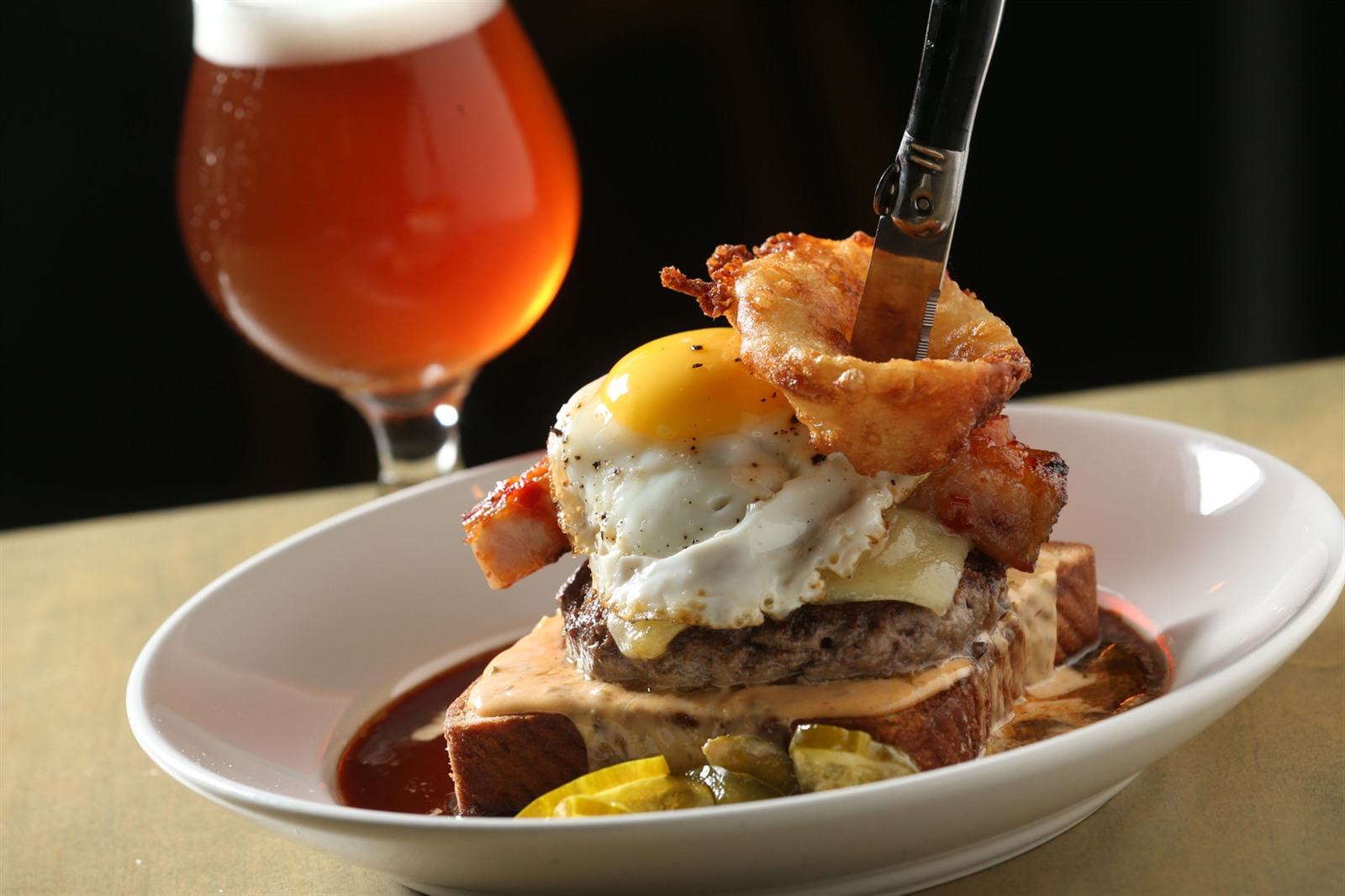 At Thin Man Brewery, the Tokyo burger offers 8 ounces of natural beef, bone marrow, glazed pork belly, Gruyere cheese, pickles, caramelized onions, spicy remoulade, fried egg and au poivre sauce on brioche.