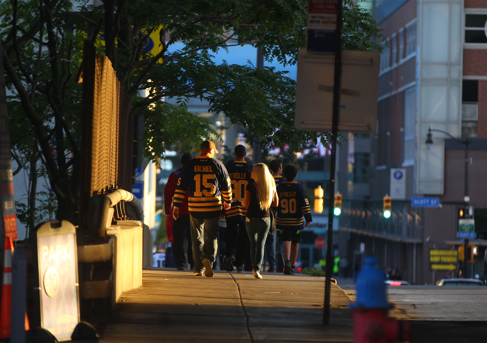 Sabres fans walk down Washington Street to the KeyBank Center for the preseason game between the Ottawa Senators and the Buffalo Sabres on Tuesday, Sept. 27, 2016.