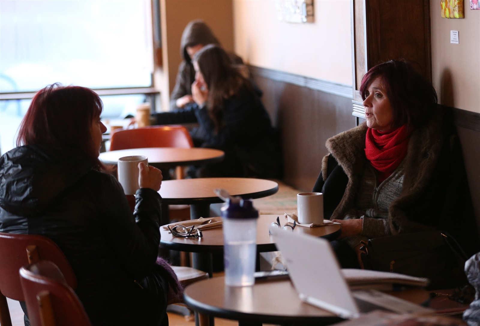 Barbara Bauers, left, of Buffalo and Colleen Enser of Grand Island enjoy some coffee and conversation.
