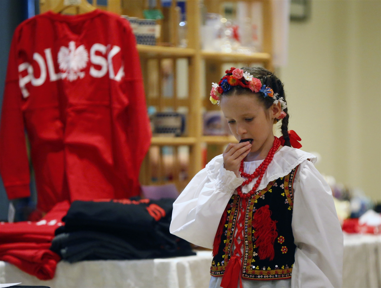 Genevieve Micelli enjoys a sweet treat during a Celebration of Polish Women event at the Holy Mother of the Rosary Parish hall in Lancaster.
