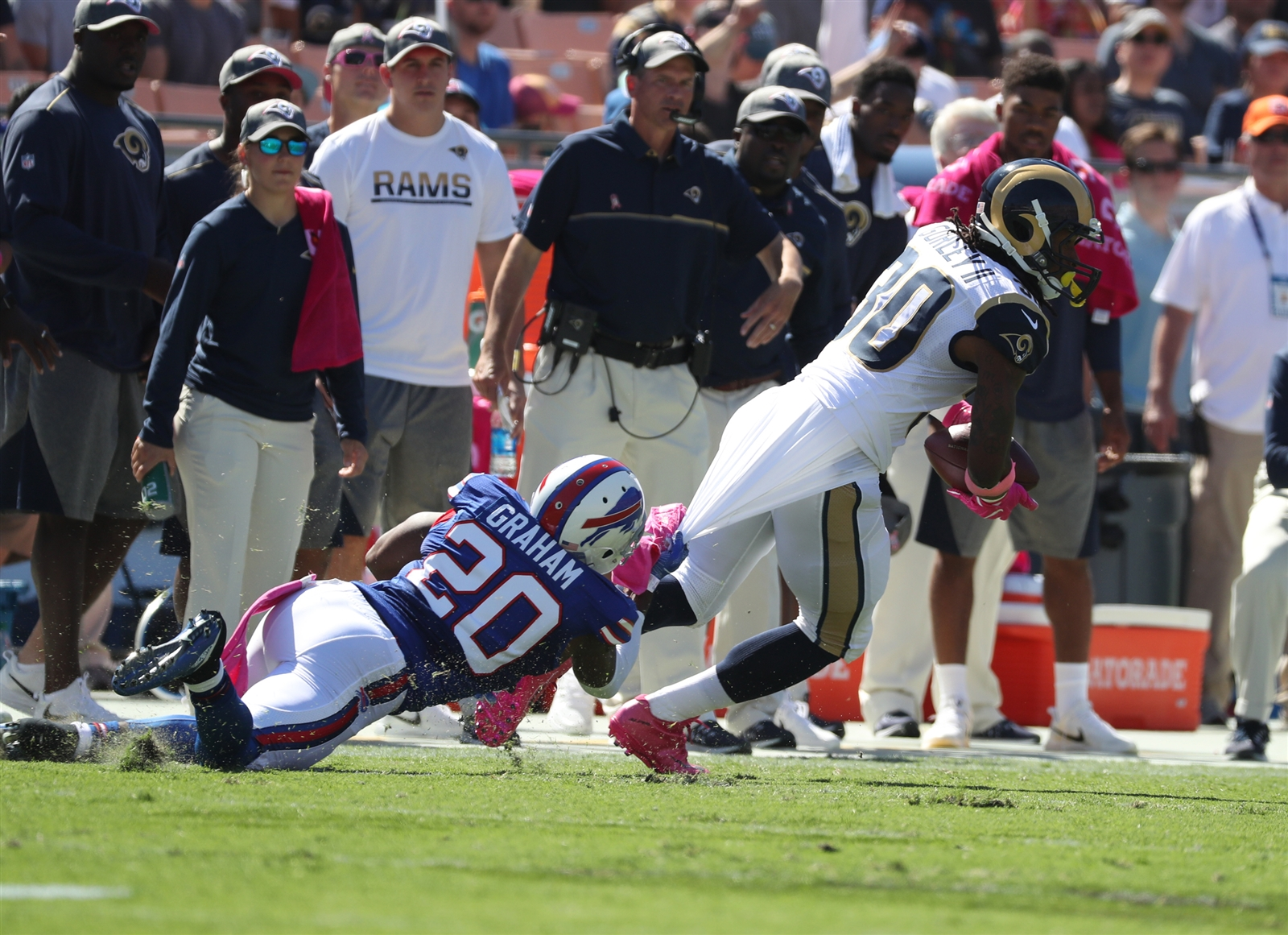Bills safety Aaron Williams (20) tackles Los Angeles Rams running back Todd Gurley (30) in the first quarter at the Los Angeles Memorial Colliseum.