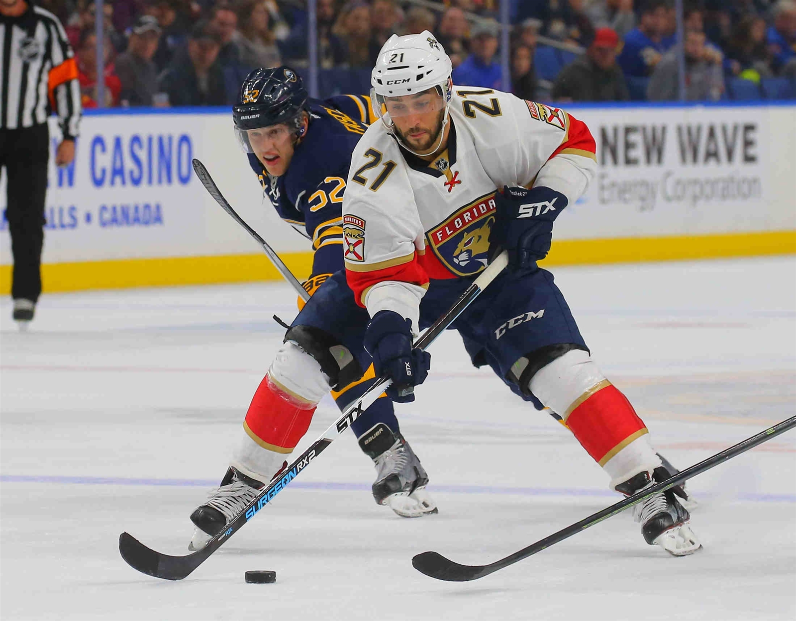 Florida Panther's Vincent Trocheck (21) works past Buffalo Sabres Hudson Fasching (52) in second period action.