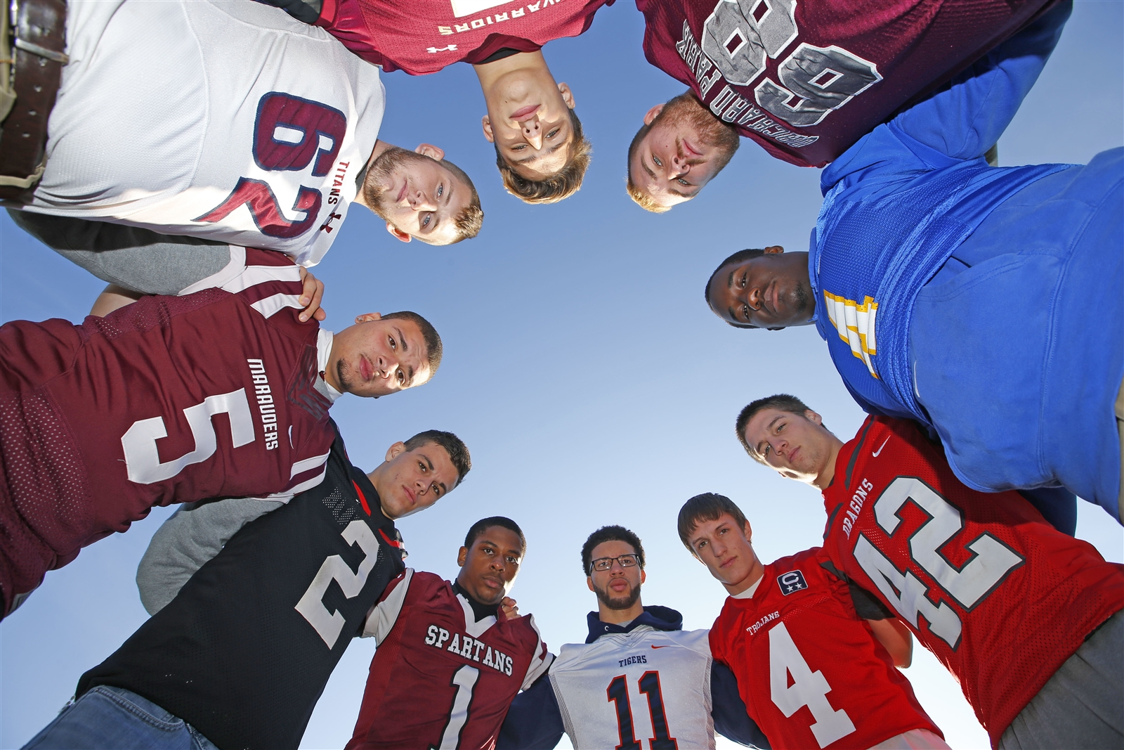 Football players representing the 10 schools playing in the Section VI playoff games pose for a photo during Media day at New Era Field on Tuesday, Nov. 1, 2016.
