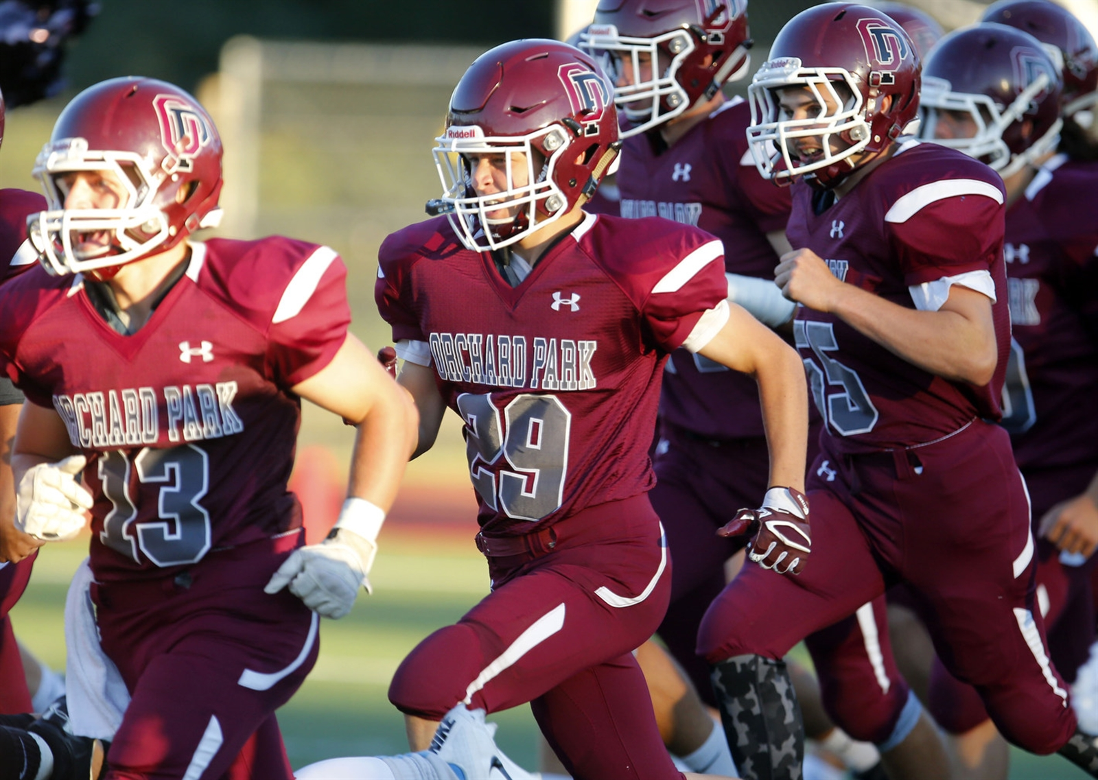 Jacob Kohler (29) takes the field with his Orchard Park teammates for the season opener against Pittsford Mendon Sept. 2 at OP.