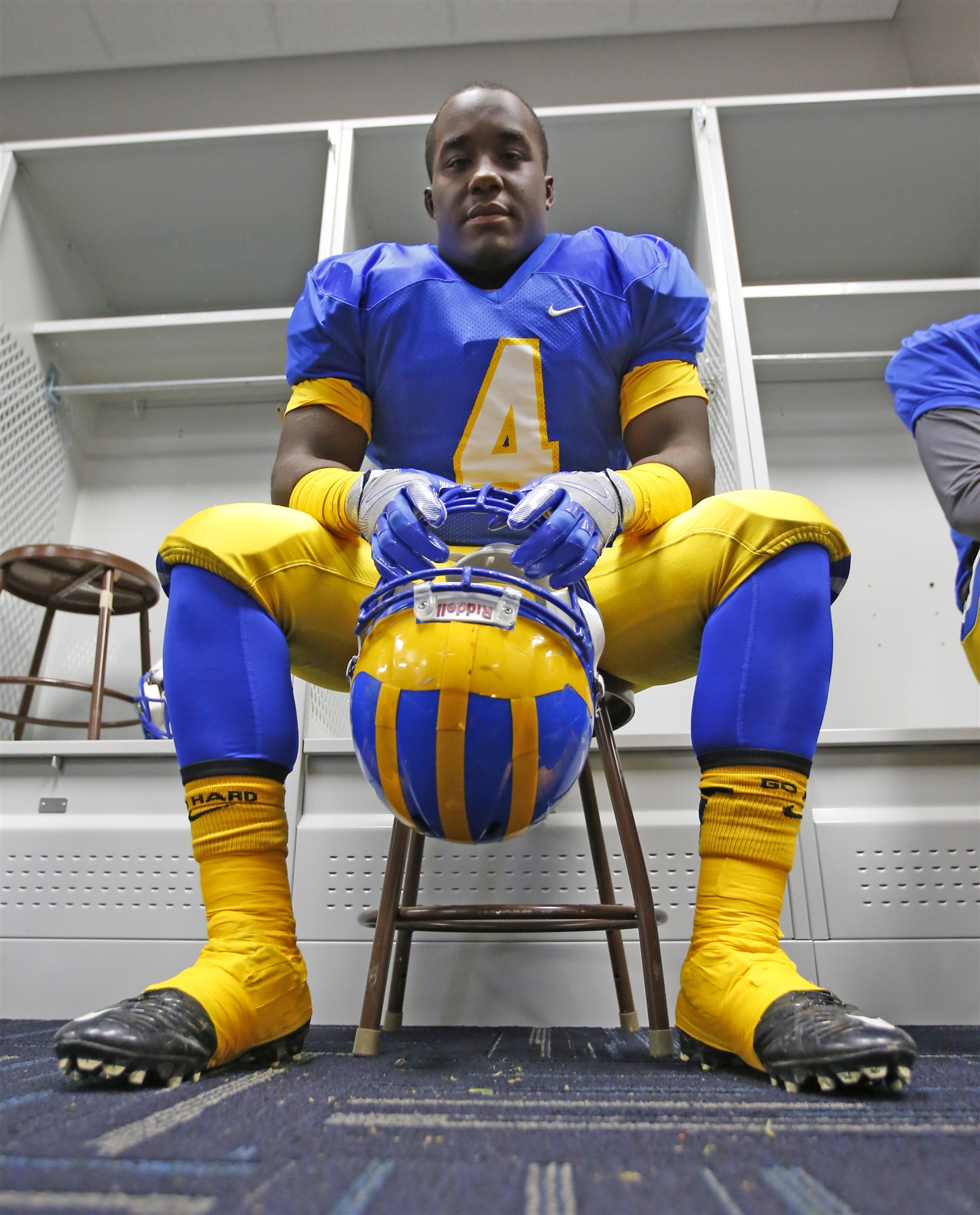 Cleveland Hill running back Matt Eldridge sits at a locker prior to the game.