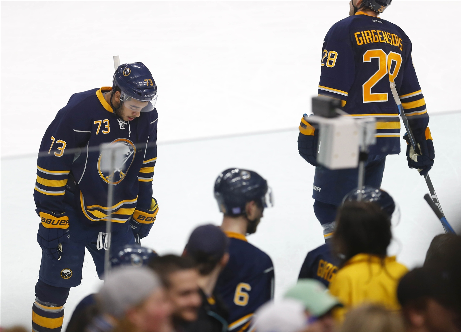 Buffalo Sabres Nicholas Baptiste, left, Zemgus Girgensons and their teammates leave the ice after losing, 4-1, to the Tampa Bay Lightning.