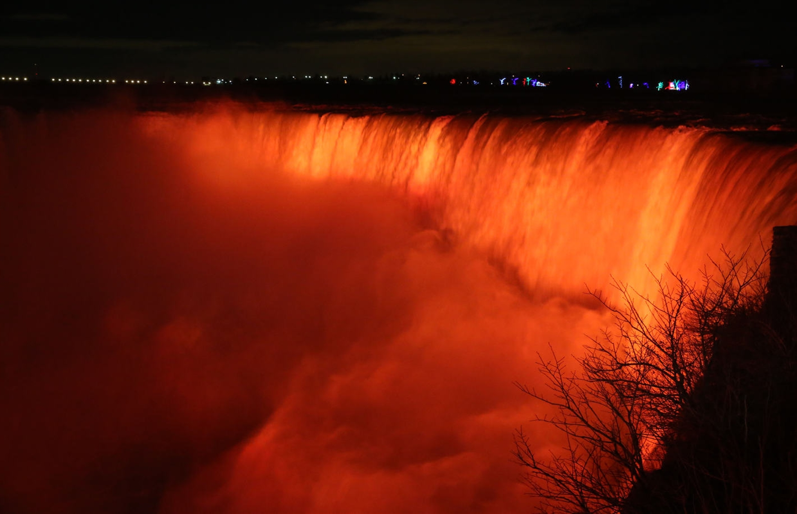 The Horseshoe Falls is lit up in bright orange.
