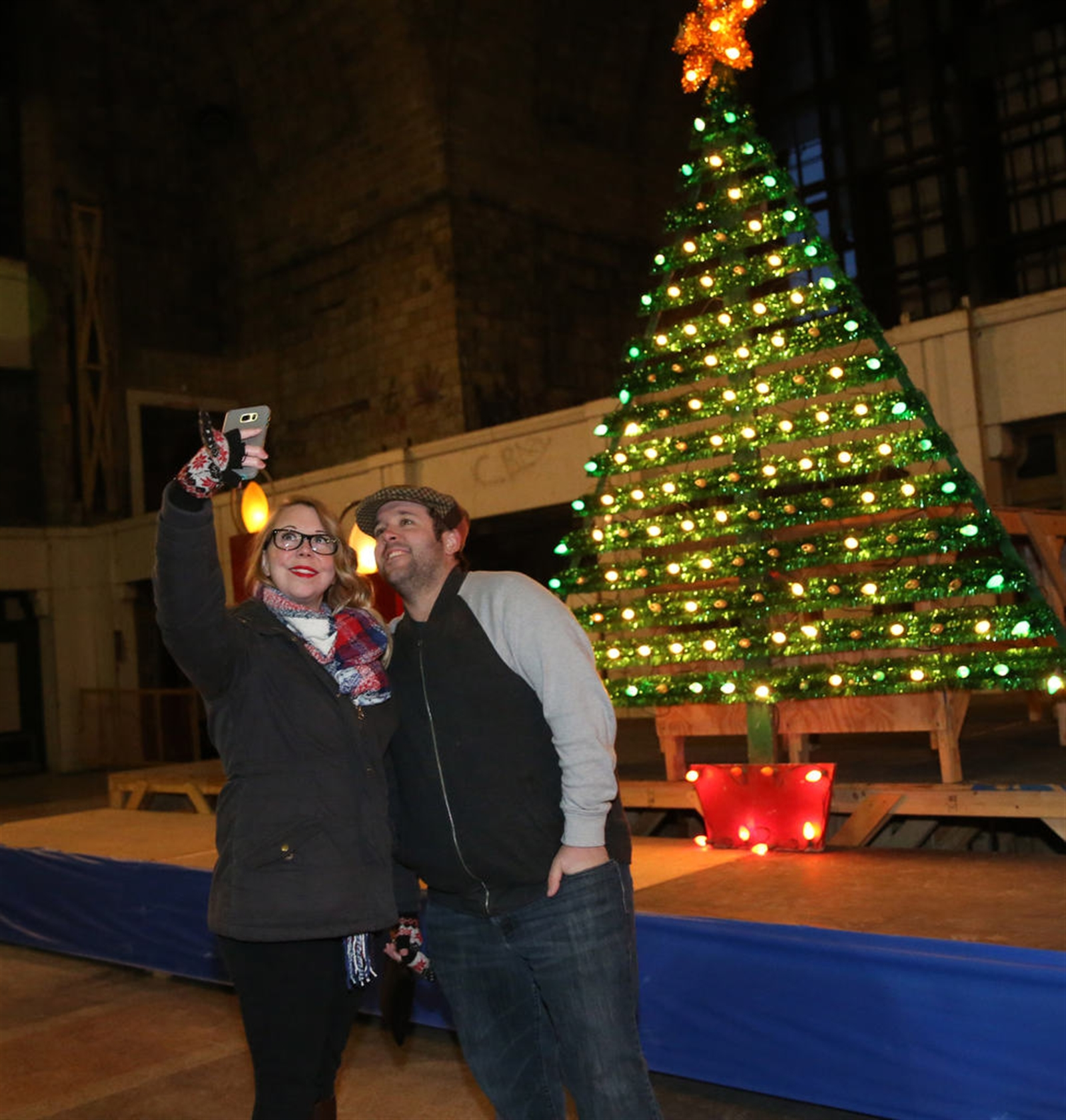 Cassie and Kevin Townsend take a selfie in front of a Christmas tree decoration that used to decorate the front of the Buffalo Forge Company at 490 Broadway in Buffalo. It's their first time in the Central Terminal.