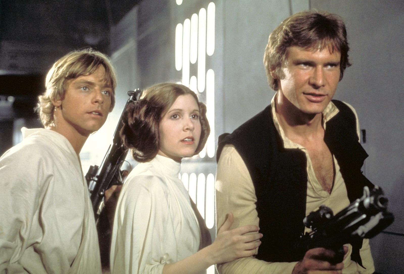 "Luke Skywalker (Mark Hamill), Princess Leia (Carrie Fisher) and Han Solo (Harrison Ford) in the original ""Star Wars."" (Lucasfilm)."