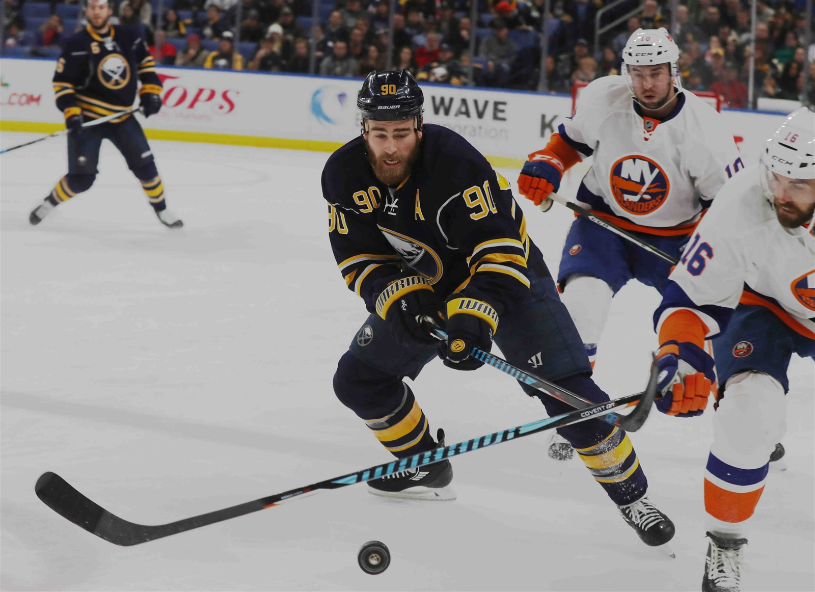Buffalo Sabres center Ryan O'Reilly (90) battles New York Islanders left wing Andrew Ladd (16) for the puck.