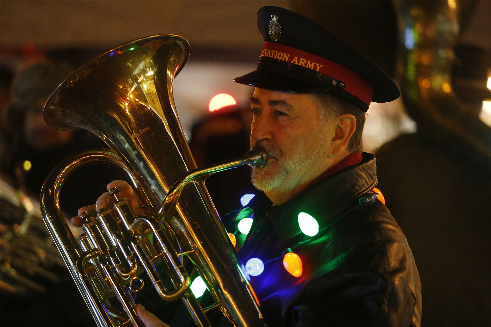 Major Tom Applin of the Salvation Army Band warms up his Euphonium on Main Street.