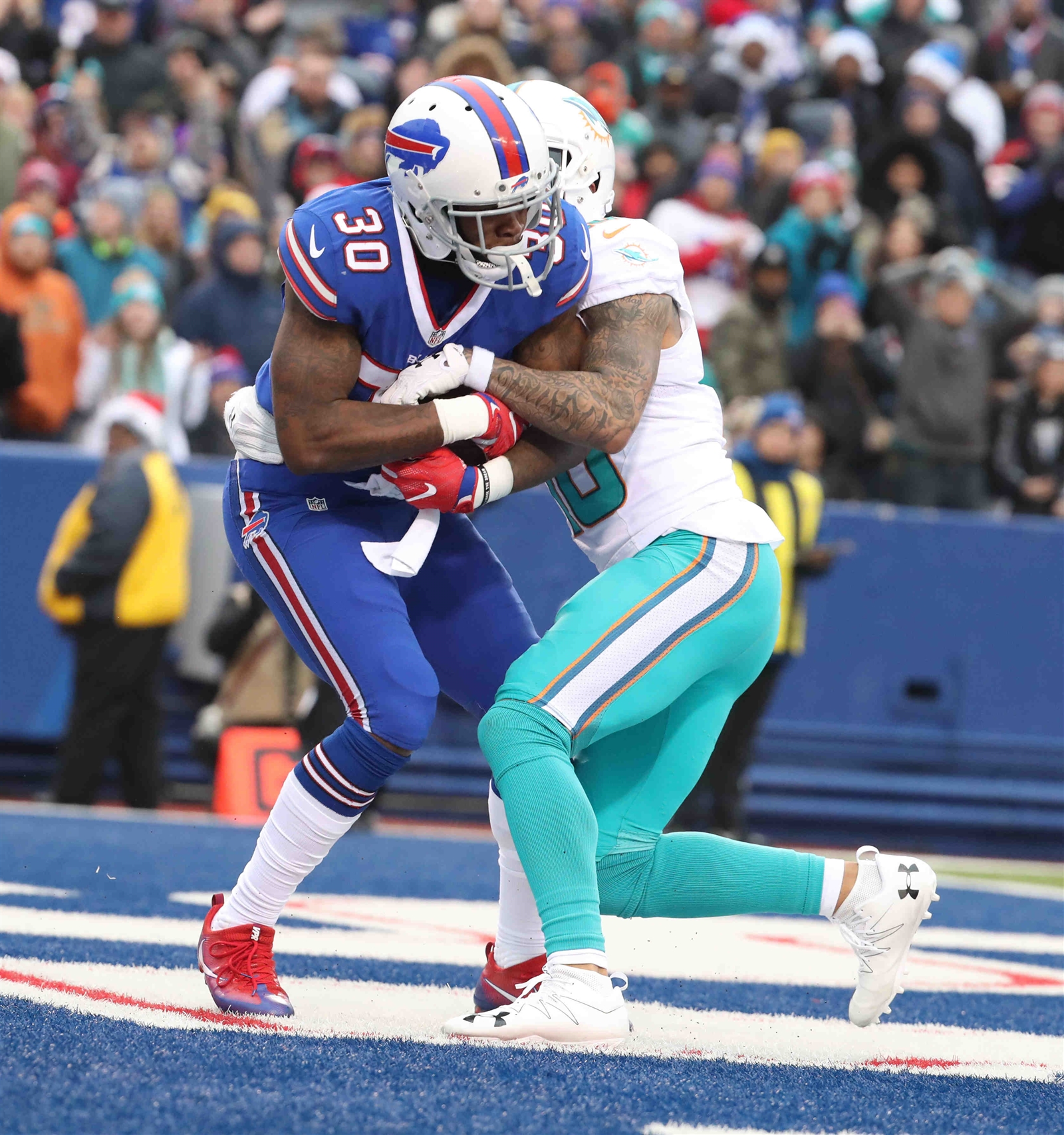 Bills cornerback Corey White intercepts the ball in the second quarter Saturday against the Dolphins.