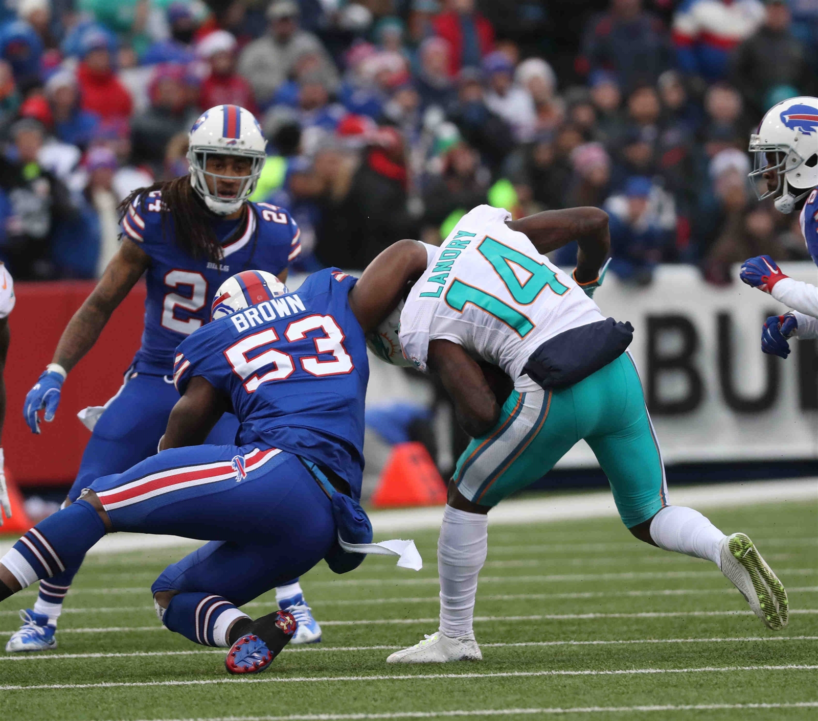 Bills inside linebacker Zach Brown tackles Dolphins wide receiver Jarvis Landry in the first quarter.