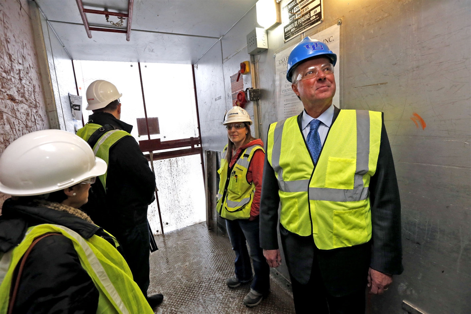 Ub jacobs school of medicine and biomedical sciences the buffalo news on dec 14 2016 dr michael e cain wearing blue malvernweather Image collections