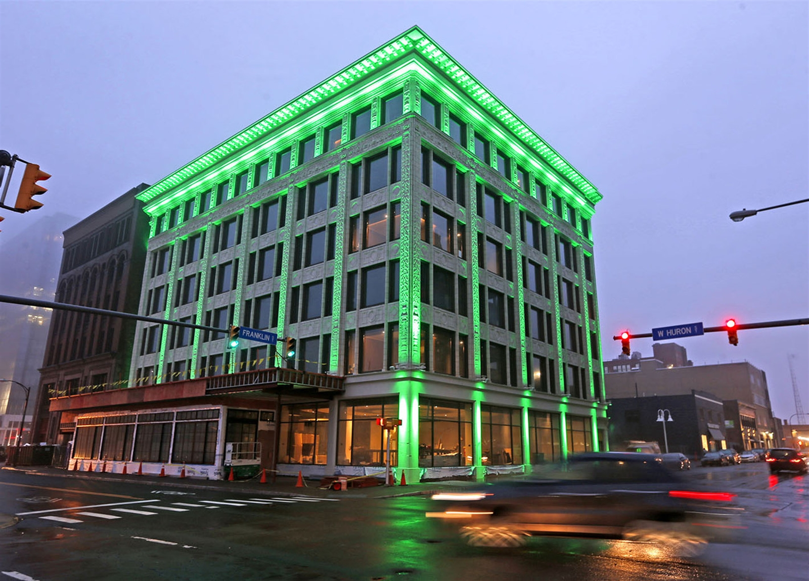 The new exterior lighting changing from white to green and other colors. The office building was constructed in 1912-1913 and added to the National Register of Historic Places in 2008.