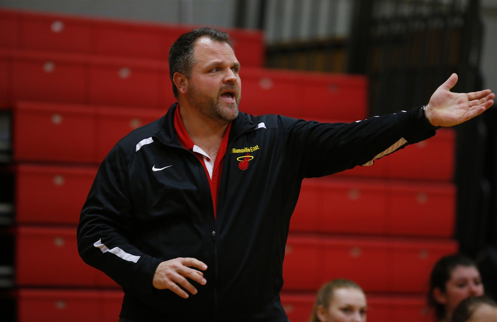 Williamsville East coach Chris Durr calls out to his team against Kenmore East during first half action of a 49-42 loss to the Bulldogs.