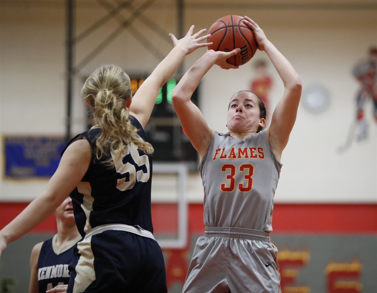 Williamsville Eastu2019s Rachel Romanowski shoots against Kenmore East. She led the Flames with 12 points.