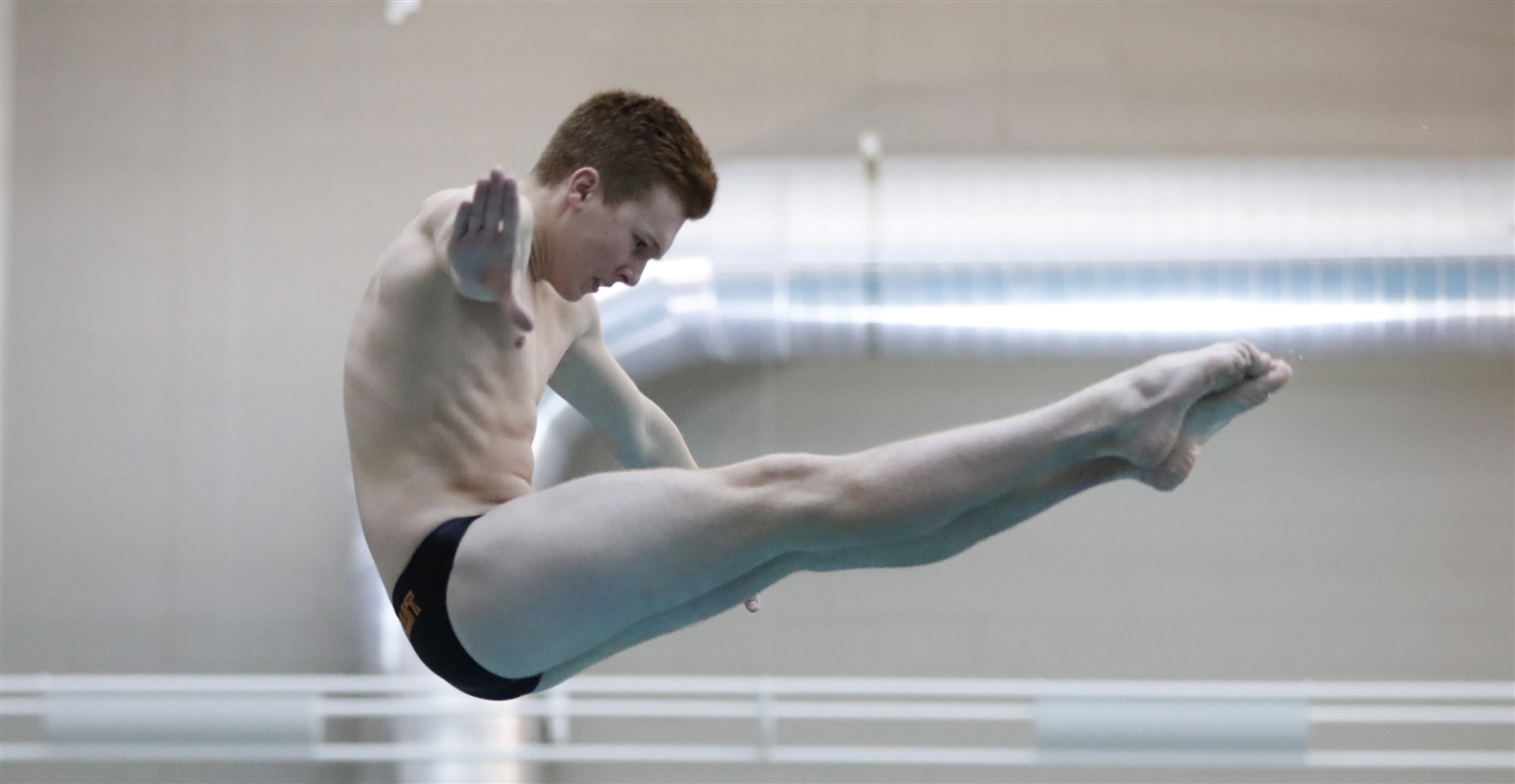 Tim Finley from Williamsville East high school, dives during the Section VI Class Meet Diving championships at Maryvale High School on Friday, Feb. 3, 2017. (Harry Scull Jr./Buffalo News)