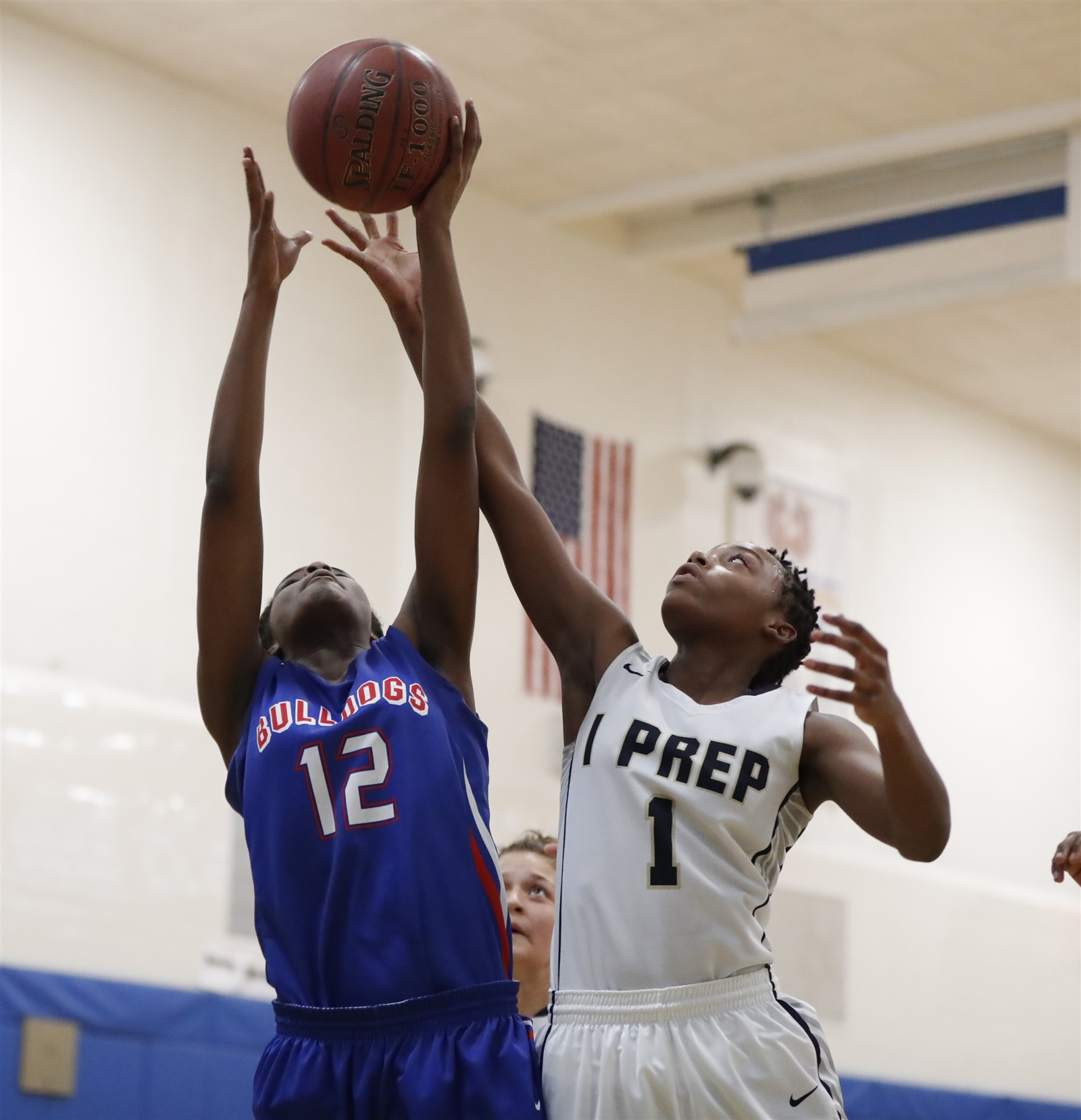 Burgardu2019s Malieka Truitt and I-Prepu2019s Anya Green battle for a rebound during first-half action at International Prep at Grover on Thursday, Feb. 9, 2017. (Harry Scull Jr./Buffalo News)