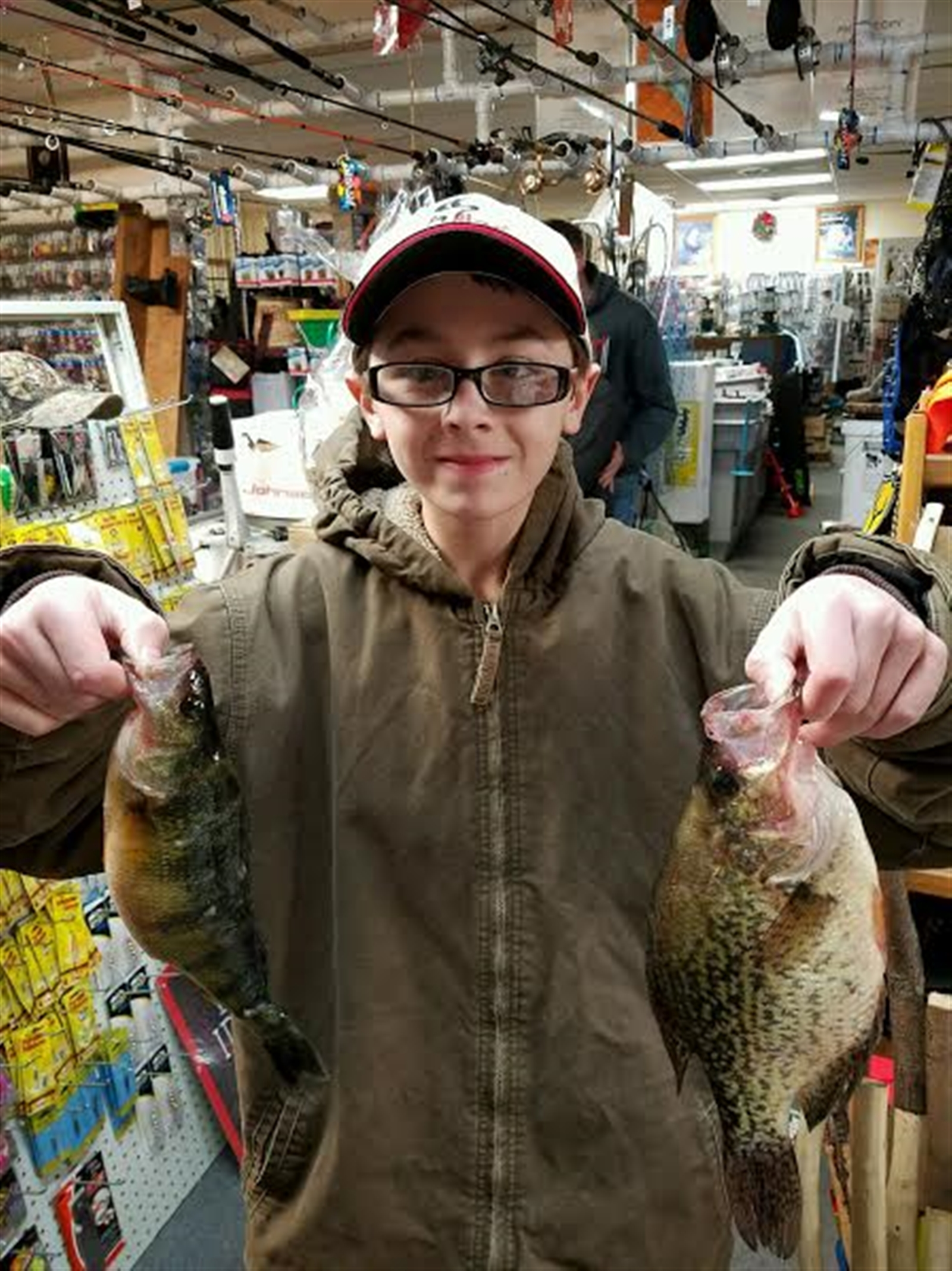 Austin Schmitt of Lockport shows off some fish caught on Honeoye Lake through the ice over the weekend. This was dinner!