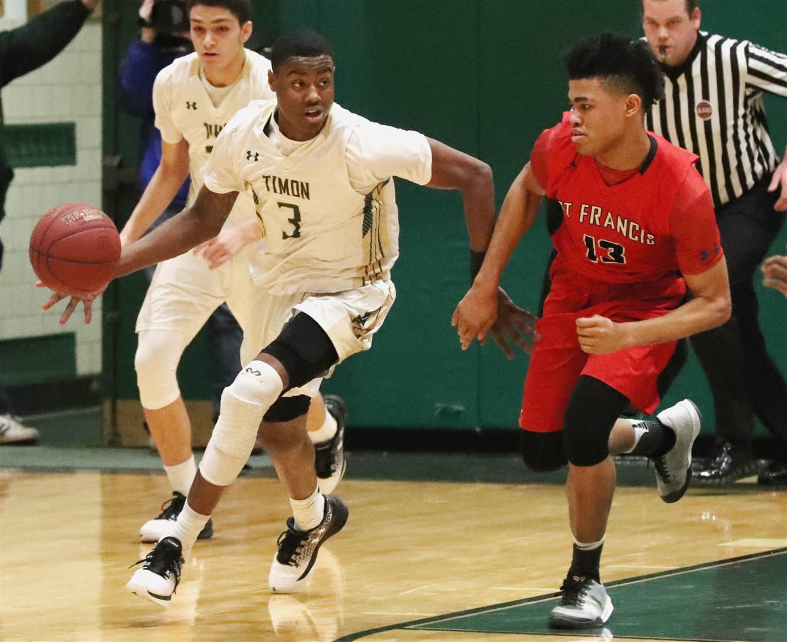Bishop Timon-St. Jude's Davion Warren steals the ball away from St. Francis' Roburt Welch in the first half of Timon's 60-55 win over No. 1 boys large school St. Francis.