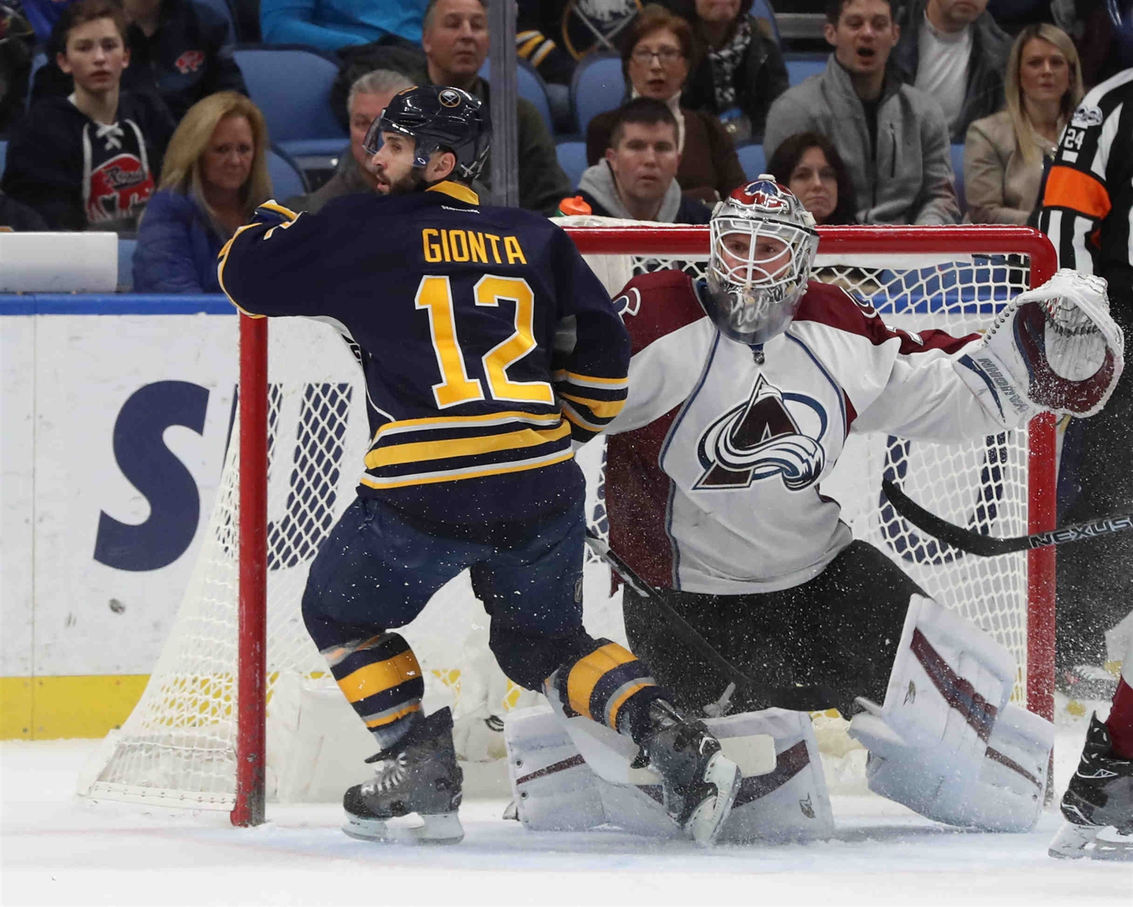 Buffalo Sabres right wing Brian Gionta (12) battles Colorado Avalanche goalie Calvin Pickard (31) for the puck in the first period.