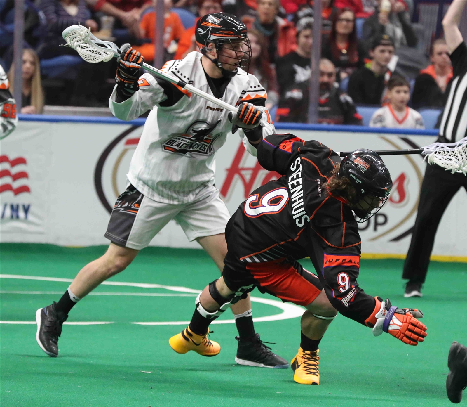 Buffalo Bandits' Mark Steenhuis battles New England Black Wolves' Zak Reid for the ball.