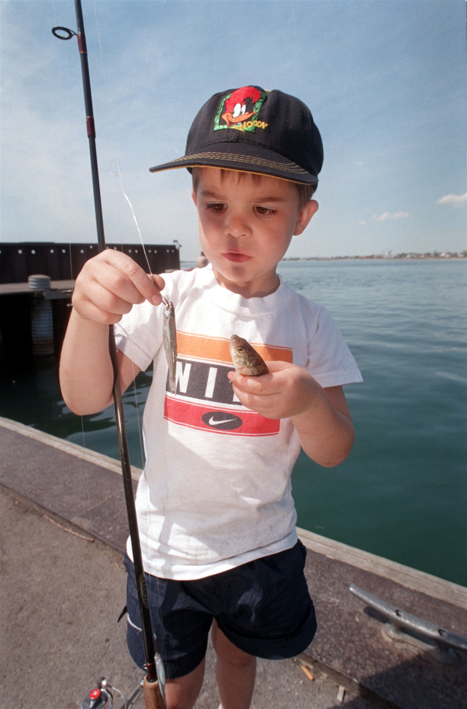 From June 2013: Devin Kiblin, 4, of Buffalo, checks a small perch he caught fishing off the Ontario Street boat landing.
