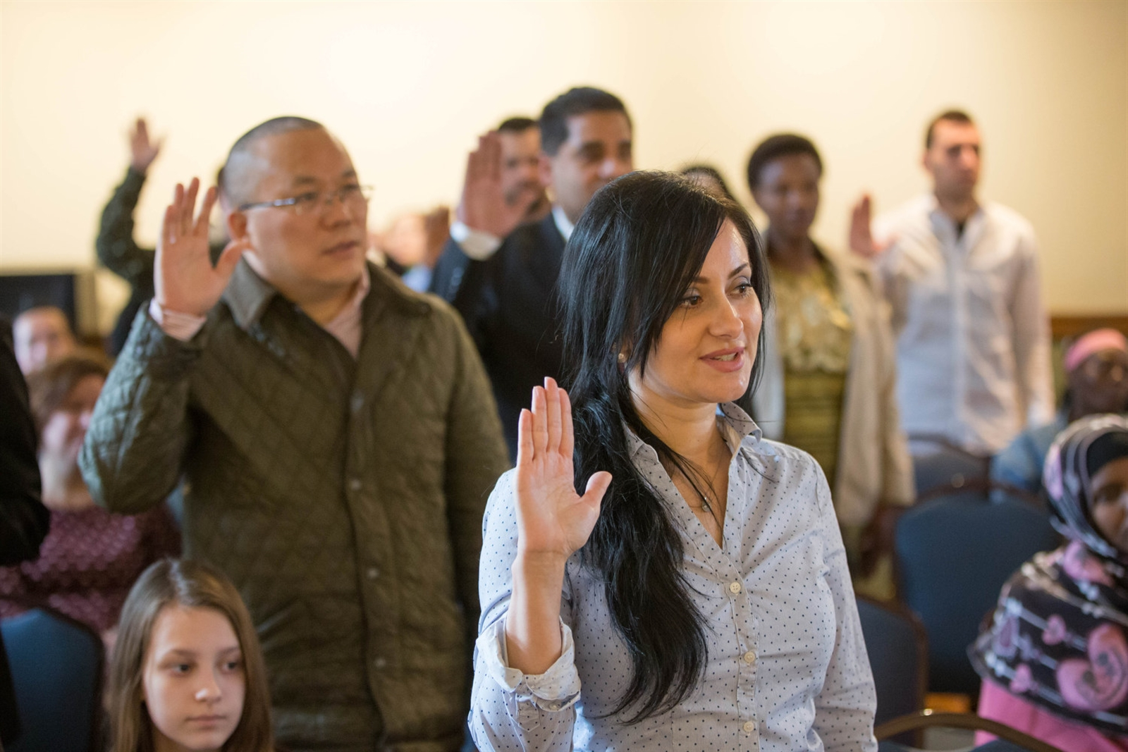 Margarita Johnson of Ukraine takes the oath of allegiance to become a U.S. citizen during a naturalization ceremony at the Theodore Roosevelt Inaugural National Historic Site, Tuesday, Feb. 21, 2017.